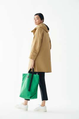 Coat by Orchival, trousers by Arket, trainers by Santoni, bag by Bagsinprogress