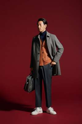 Coat by Altea, cardigan by Rainmaker, rollneck jumper by Sovereign from The Sovereign House, trousers by Allege, socks by Beams, trainers by Bottega Veneta, bag by Porter from Kura  Chika Yoshida
