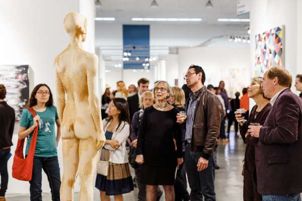 Attendees view 'Il Raccolto' by Aron Demetz