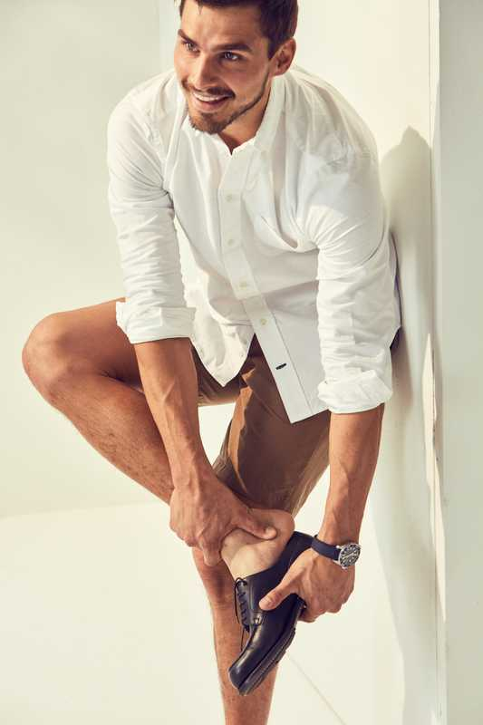 Shirt by Gitman Vintage,  shorts by Goldwin, shoes by JM Weston, watch by Tag Heuer