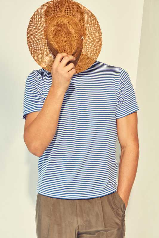 T-shirt by Fedeli for Drake's, trousers by Ermenegildo Zegna, hat by Mühlbauer