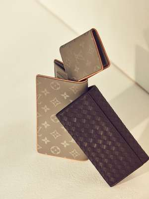 Wallet and card case by Louis Vuitton, wallet by Bottega Veneta