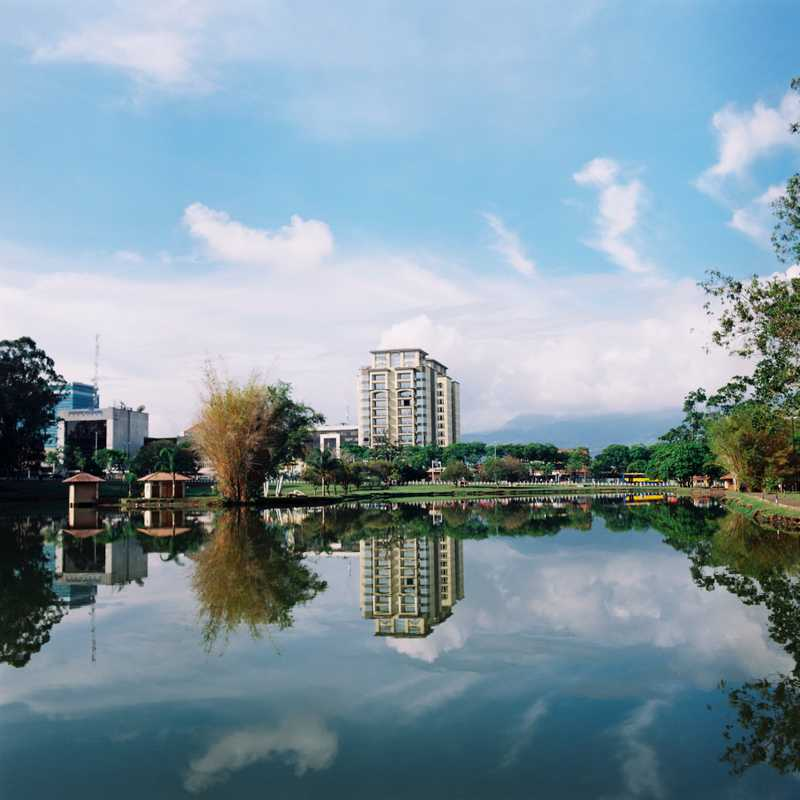 Modern buildings and quiet water in Parque La Sabana