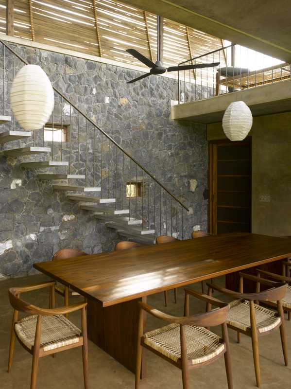 Local stone and wood give an earthy feel to the modern design