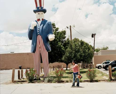 'Uncle Sam' towers over a Hispanic woman, New Mexico