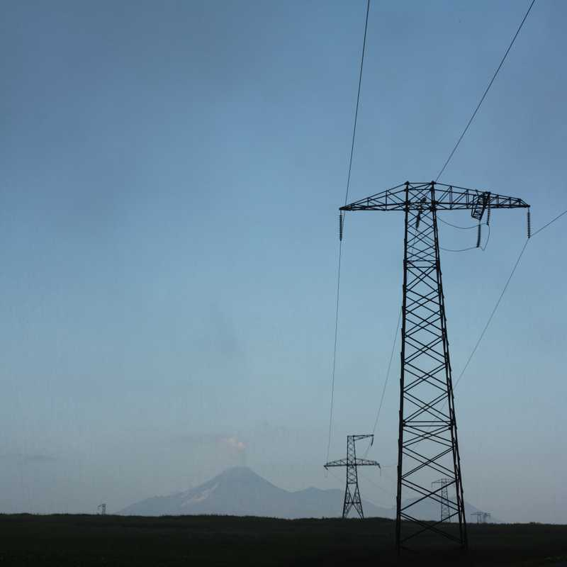 The Koryaksky volcano smokes beyond pylons outside Petropavlovsk