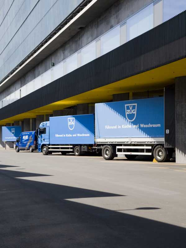 V-Zug lorries lined up outside the logistics building