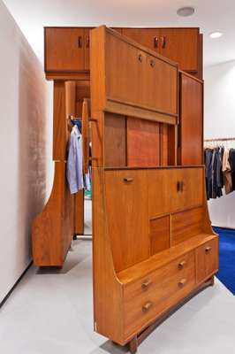 Cupboards designed by Michael Samuels double as fitting rooms