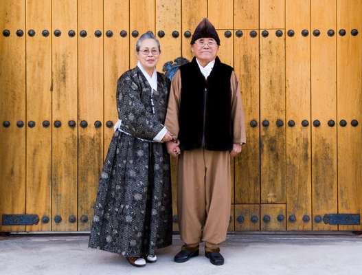 Lee Bong-ju and his wife, the designer Sa Jun-ja, wearing traditional formal dress