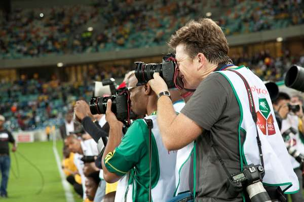 Photographers gathered by the pitch