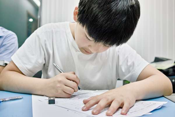 'Hagwon' pupil re-checks his test paper