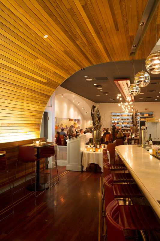 The restaurant's high, wood-covered ceiling