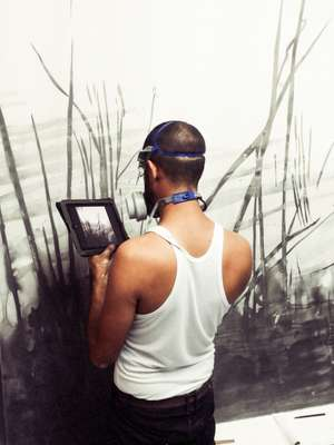 Frank Mujica at work on a large-format graphite drawing