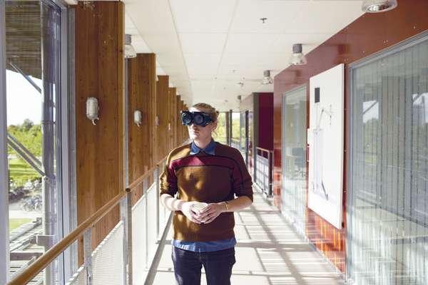 A student at Sweden's Lund University wears goggles that simulate eye problems