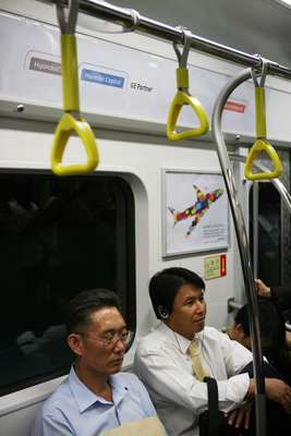 South Korean commuters inside a Line 9 subway car