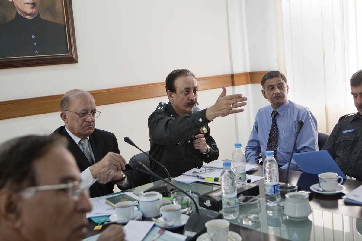 Ahmed in a meeting with fellow officers