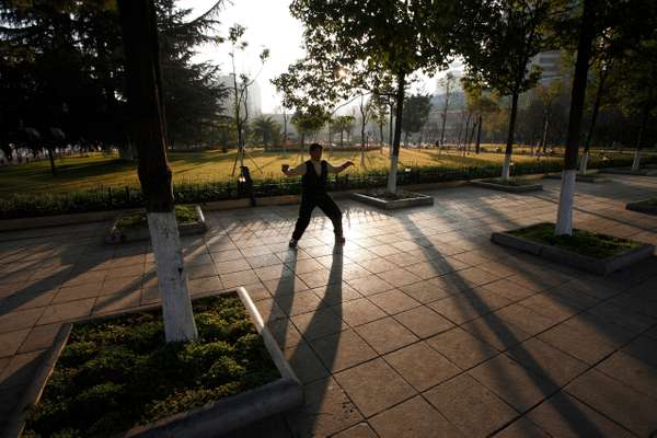 Early morning exercising in Dong Feng Square