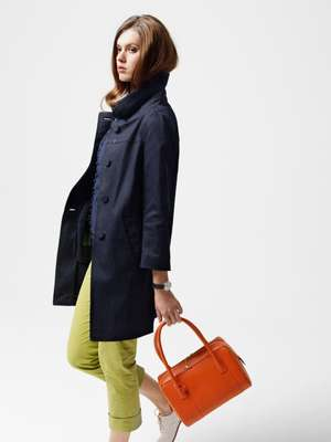 Coat by Prada, cardigan and blouse by Thomas Pink, trousers by Incotex, shoes by Margaret Howell, watch by Georg Jensen, bag by Delvaux