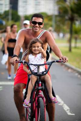 Marcello and daughter Kiara, visiting family from Los Angeles, take a Rio ride