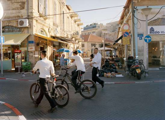 Ultra Orthodox young Israeli Jews walk through Jaffa's flea market
