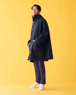 Coat by Cini, trousers by Tomorrowland Pilgrim, socks by United  Arrows, trainers by Golden Goose Deluxe Brand