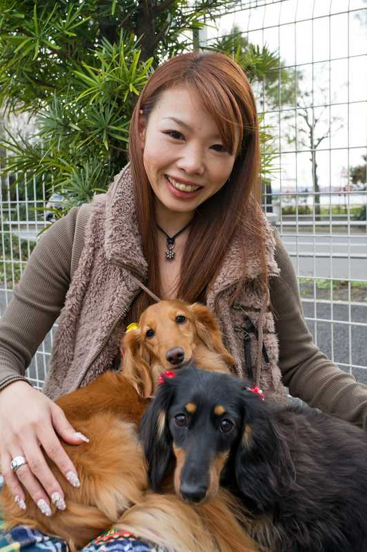 Megumi Karasawa with Bell (gold) and Niko (black tan)