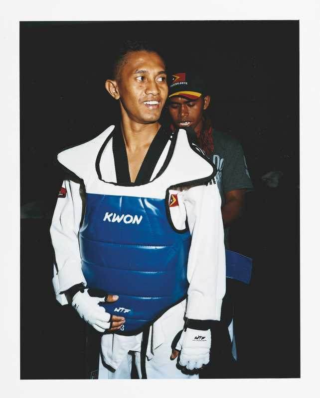 A member of the Timor Leste taekwondo team gets kitted up