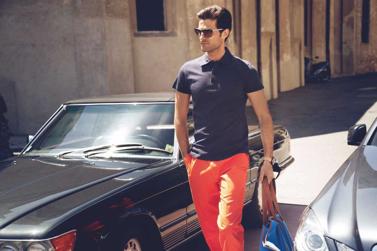 Sunglasses by Lindberg, polo shirt by Sunspel, trousers by Caruso, watch by Bell & Ross, bag by Hackett