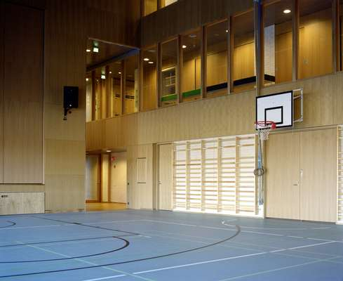 The beech-clad gymnasium, which doubles as a performance space