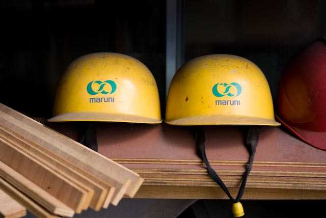 Company logo on the hard hats