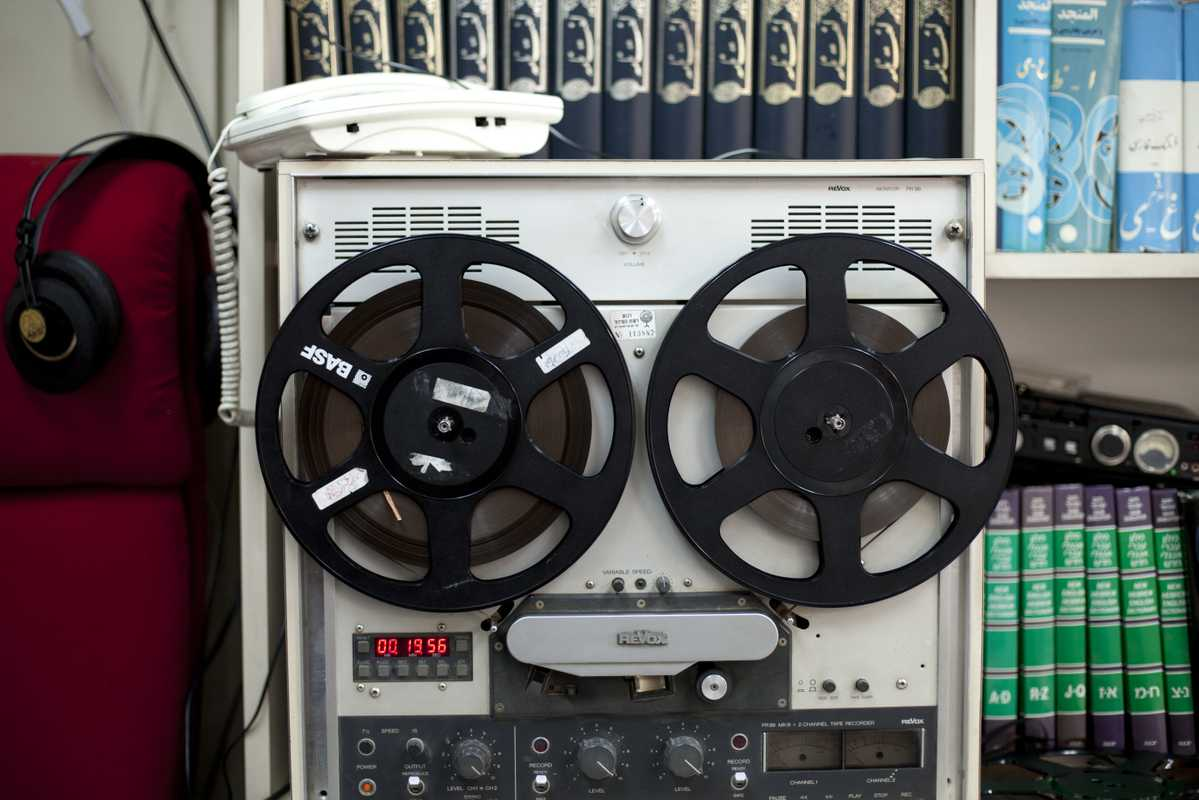 Hebrew and Farsi dictionaries behind a reel- to-reel tape recorder