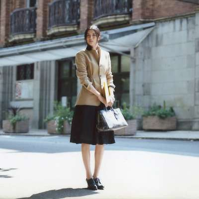 Jacket, skirt, under skirt by Dries Van Noten, shirt, bag by Prada, shoes by Black Fleece by Brooks Brothers, watch by Hermès
