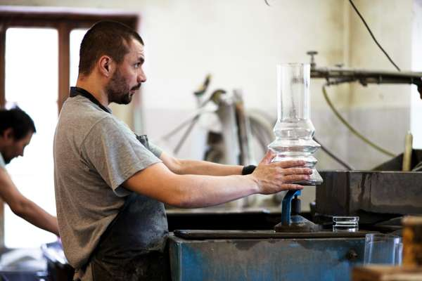 A worker in the polishing workshop checks that a piece is level