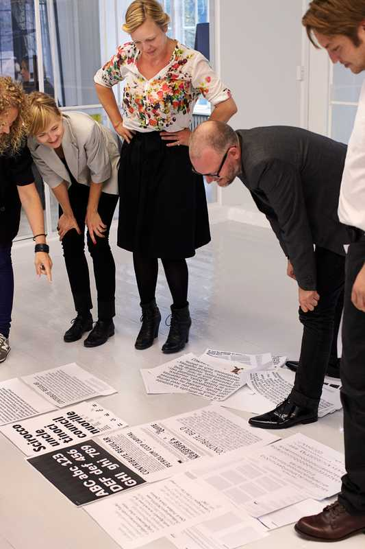 Jens Kajus and colleagues inspecting fonts in the office of e-Types