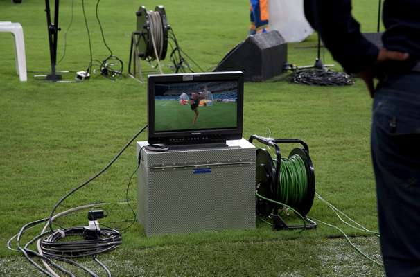 TV monitor at the side of the pitch