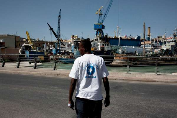 Man outside the centre for migrants at Marsa