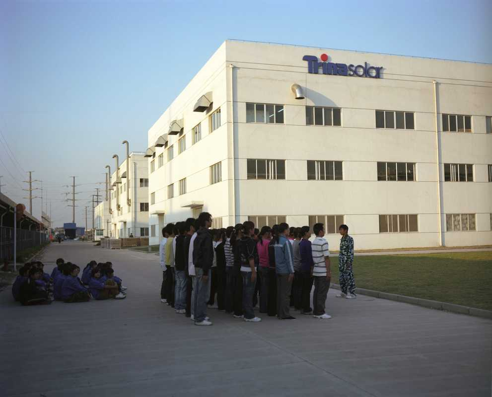 New employees in front of Trina Solar's factory