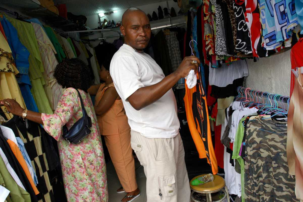 A Congolese man buys Chinese-made clothes