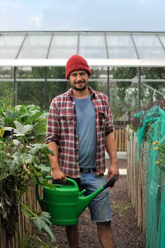 Farmer and agriculture expert Bram Stessels gets watering