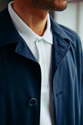 Coat by Herno, poloshirt by Brooksfield