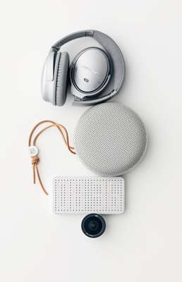 Headphones by Bose, speaker by Bang & Olufsen, mobile battery by Power Cube Pro from Best Packing Store, lens by ExoLens Pro from Best Packing Store
