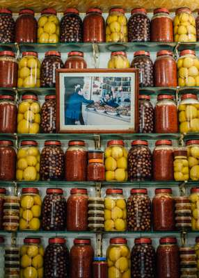 Portrait surrounded by pickled lemons and olives in the souk