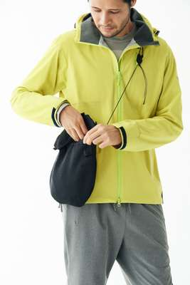 Jacket by Helly Hansen, t-shirt by TS(S), trousers and bag by  Alk Phenix