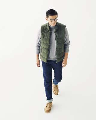 Down vest by Herno, rollneck jumper by Orazio Luciano, jeans by Jacob Cohen, glasses by Ray-Ban