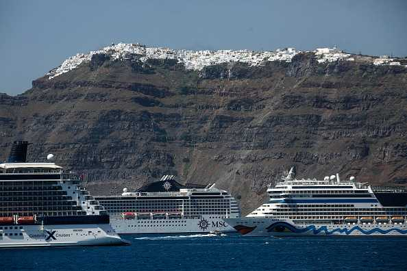 Cruise ships sailing past the Aegean island of Santorini