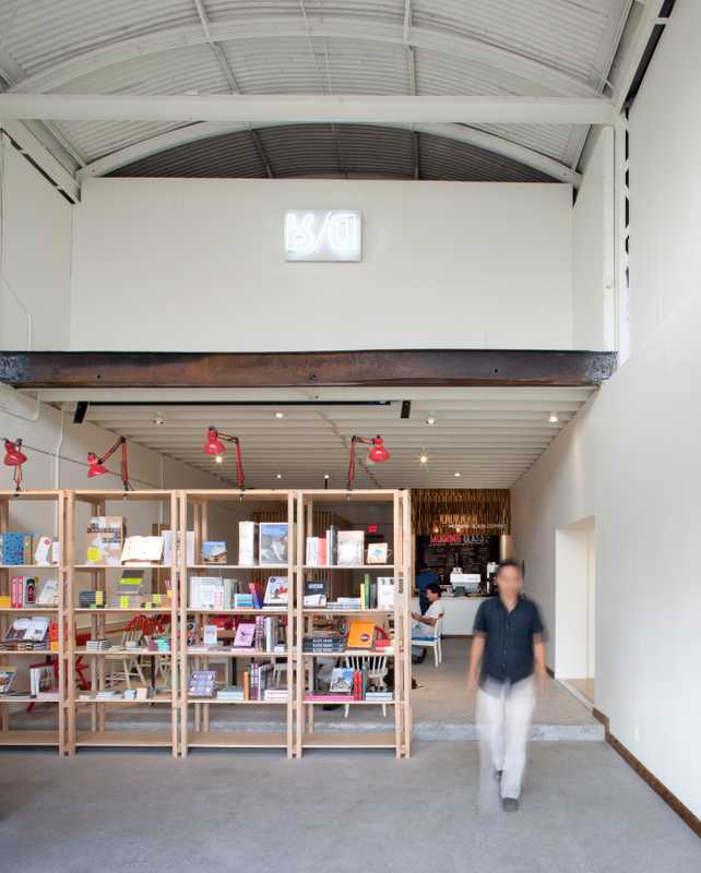 02. This bookstore and café is partitioned by shelves made by local craftsmen