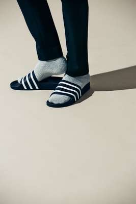 Trousers by Yaeca from Yaeca Apartment Store,  socks by Tabio Men, slides by Adidas Originals