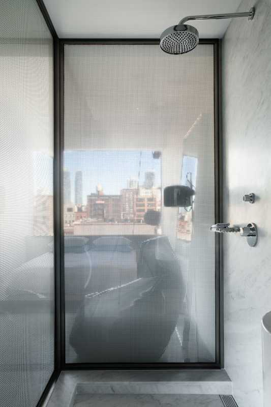 Shower looking onto Manhattan skyline