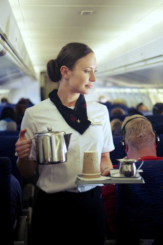 Hostess serves coffee during a FIFO flight