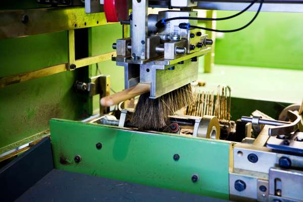 A brush being cut